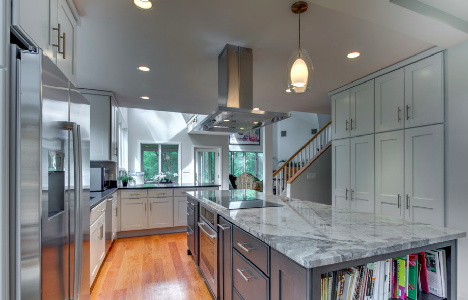 Exceptional Azul Aran Polished Granite Sits Atop A Gray Center Island In This Boston  Kitchen By
